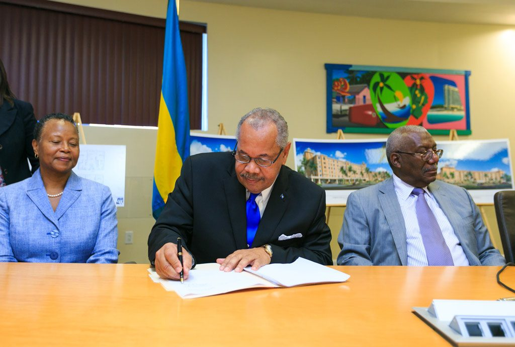 COB President Dr. Rodney D. Smith (centre) signs the contract for the construction of the University of The Bahamas Residence Hall at the Oakes Field Campus. At left is COB Provost Dr. Linda Davis and at right is College Council Deputy Chair Mr. Lowell Mortimer, OBE.