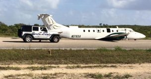 Southern Air on the airstrip in Long Island Bahamas without its landing gear deployed.