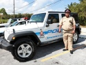 Supt. Wright standing next to one of three new Jeeps