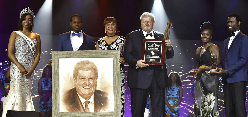 Enrico Garzaroli, owner of the historic and world-renowned Graycliff was presented the Clement T. Maynard Lifetime Achievement Award at the 17th Cacique Awards held at Baha Mar Convention Centre, Cable Beach, on Saturday, April 8, 2017. Pictured from left: Cherell Williamson, Miss Universe Bahamas; Jamal Rolle, Celebrity Artist, who produced the image of Mr. Garzaroli; Joy Jibrilu, Director General of Tourism; Enrico Garzaroli; and Presenters. (BIS Photo/Kemuel Stubbs)