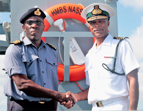 Captain Tellis Bethel, Commander Defence Force (Acting) greeting Commander Gregory Brown, Commanding Officer HMBS Nassau shortly after the craft's arrival at the Coral Harbour Base. The The 60-meter (200 foot) Bahama Class vessel arrived in the capital after undergoing maintenance and repairs at the Maaskant Shipyards in Stellendam, Holland.