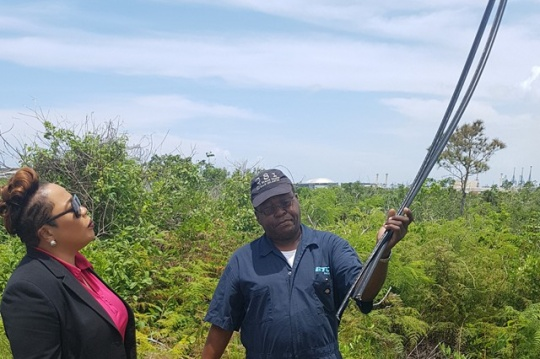 BTC Northern VP Eldri Ferguson Mackey surveys the damage along with Adrian Allen of field services following the discovery of copper cable theft in the Lewis Yard area. (Photo Courtesy of BTC for Barefoot Marketing)