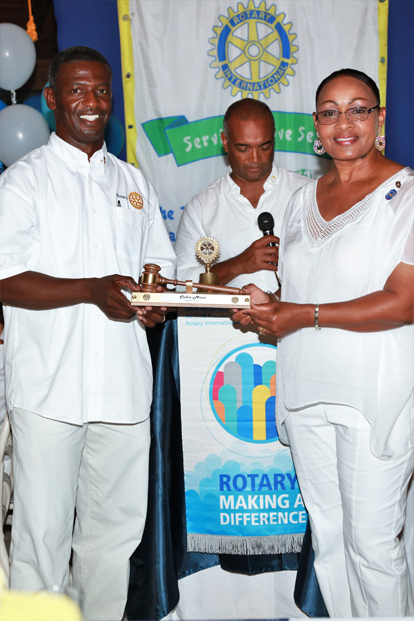 New Rotary Club of Eleuthera President Sherrin Cooper presents the Past President's gavel to Outgoing President Colin Moss.