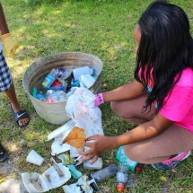 Camper sorts and records litter collected during community cleanup