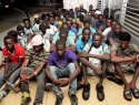 The Haitian migrants seated at the Defence Force Base after they were apprehended at Ragged Island on July 13, 2017.