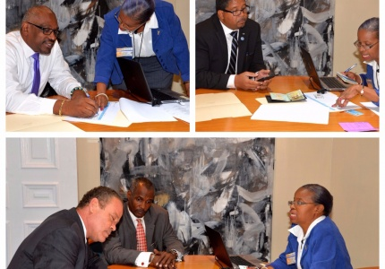 Prime Minister Minnis and Deputy Prime Minister Turnquest lead the verification process of members of the Cabinet, assisted by Mrs. Donna Delancy, Deputy Treasurer and Coordinator of the Verification of Government Monthly and Weekly Employees, Senators and Members of Parliament process. Also pictured at Ministers Bannister and Foulkes