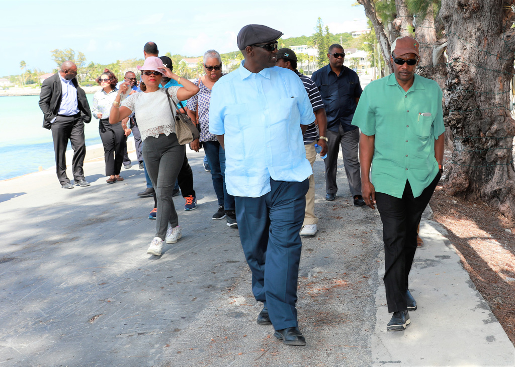 File Photo: Minister Desmond Bannister walks with Administrator Gilbert Kemp, along the bay front in Governor's Harbour during March 2018.