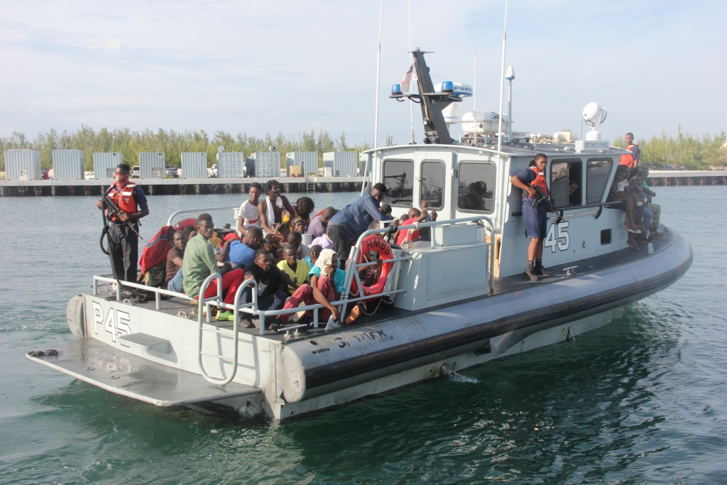 RBDF photo shows: Haitian migrants entering the Defence Force Base aboard patrol craft P-45. (Photo by Chief Petty Officer Jonathan Rolle)