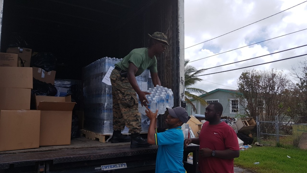 Minister Kwasi Thompson, accompanied by Defence Force Officers and volunteers, utilized a truck and handed out supplies to residents in one of the hardest hit areas of Freeport, following the passing of Hurricane Dorian.