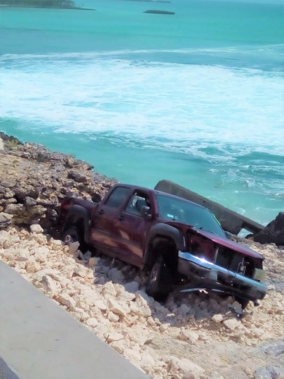 The occupants of this truck, which was tossed over the bridge by the tremendous power of battering waves, were reported to have escaped without serious injury, on Wednesday afternoon, September 18th, 2019.