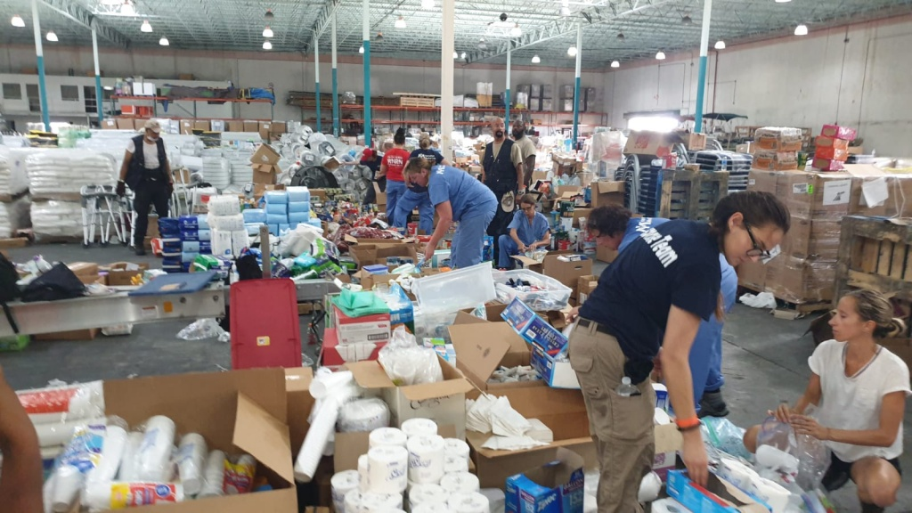 Close to 100 local and international volunteers showed up at Freeport Ship Services Warehouse on Saturday, September 14, 2019 to unload, repack and load up hurricane relief supplies that were donated to the Bahamas from Carnival Cruise Lines, Royal Caribbean and other international donors.