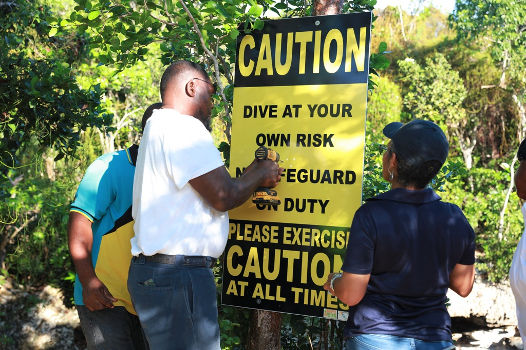 Safety signs being erected at the Sapphire Hole landmark in North Eleuthera.