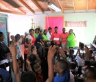 Students at Gregory Town Primary School welcome the Pineapple Fest Chairwoman and Ministry of Tourism representatives.