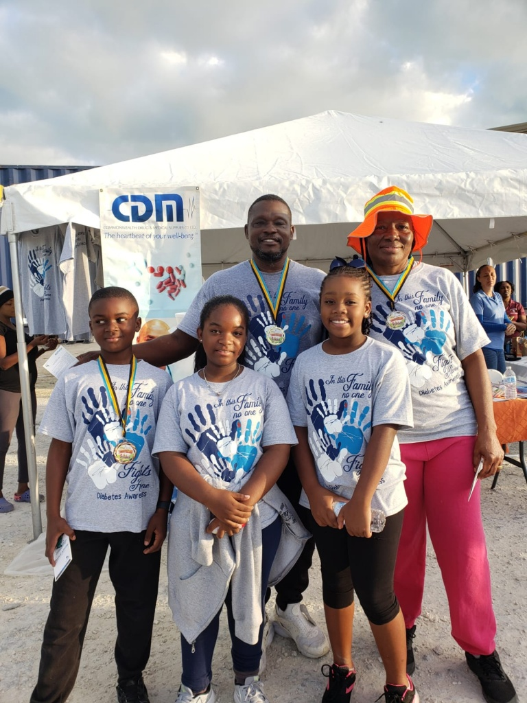 Winners in the walkathon were Mr. and Mrs. Ricardo Belle, who came in 1st and 2nd place, respectively, followed by young fifth grader, Rajon Louis in 3rd. The winners stand with Mckayla Knowles - organizer, and her friend, Arianna McIntosh.