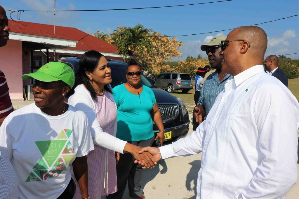Minister Dames meets residents during the walkabout in Hatchet Bay.