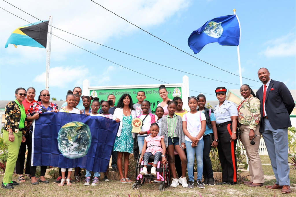 Peace Flag raised at Emma Cooper primary, now designated as a Peace Site.