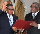 Oswald Ingraham being sworn in as Acting Governor General.