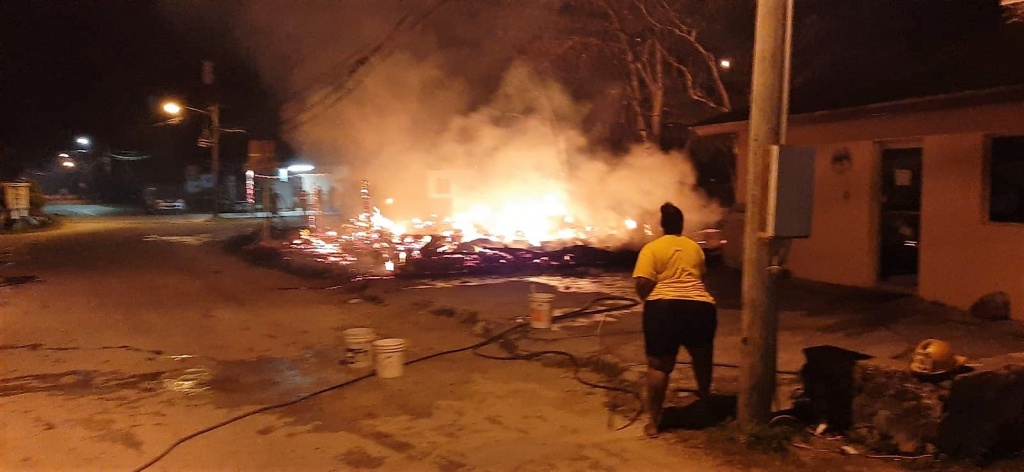 Local residents were found attempting to contain the fire.