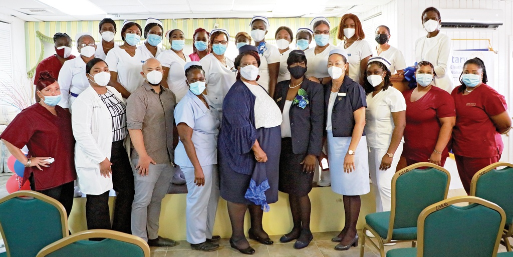 Nurse Monique Roberts-Cambridge (center right) stand with her colleagues serving in the medical profession throughout Eleuthera's community clinics.