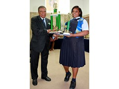 Hon. Oswald Ingraham presenting to Patrinique Adderley (prefect) of the Class of 2016 - 490A7436