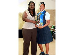 Ms. Jamie Williams presenting the Coaches Award to graduate, Wendeisha Symonette - 490A7597