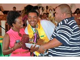 Honour roll student Cortez Cooper (Head Boy) of the CEHS  Class of 2016 surrrounded by his parents -   490A7049