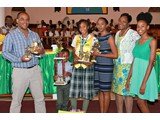 Honour Roll student of CEHS, Valedictorian of the  Class of 2016 & Head Girl, Safyha Bryan, surrounded by her family and the District Supt. Helen Simmons-Johnson - 490A7081