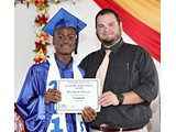Valedictorian of the WHS Class of 2016, Naaman Rolle, receiving an award in Computer from teacher Mr. Yates - 490A3263
