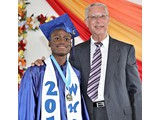 Valedictorian of the WHS Class of 2016, Naaman Rolle, with campus pastor Mr. Schrag - 490A3264
