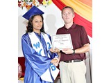 Salutatorian of the WHS Class of 2016, Brittany Ingraham, receiving an award in Music from Mr. Turner - 490A3276