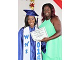 Ivanna Ferguson, of the WHS Class of 2016, receiving an award in Physical Education  from teacher Ms. Campbell - 490A3281