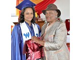 Brittany Ingraham, Salutatorian of the WHS Class of 2016, receiving a gift from Evangelist Shirley Burrows- 490A3289