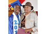 Naaman Rolle, Valedictorian of the WHS Class of 2016, receiving a gift from Evangelist Shirley Burrows- 490A3290