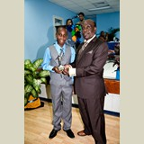 Primary School male of GHPS, Omarion, awarded for his achievements in sports- 490A7139
