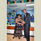 Collecting an award for a student athlete- 490A7144