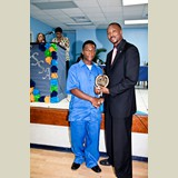 High School male of PHAHS, Browley, awarded for his achievements in sports- 490A7150