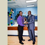 High School male of PHAHS, Shawn, awarded for his achievements in sports- 490A7179