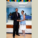 Mr. Michael Culmer accepting an award for Mr. James Ingraham, for his service in sports- 490A7252