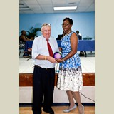 Mr. Tony Crean being awarded by Superintendent of the Eleuthera Education District, Helen Simmons-Johnson for his service in sports- 490A7254