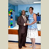 Mr. Johnny Butler being awarded Superintendent of the Eleuthera Education District, Helen Simmons-Johnson for his service in sports- 490A7256