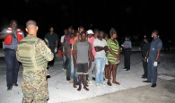 Haitian migrants after they were brought into the capital early Wednesday morning.