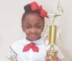 Tamia Knowles with trophy-feature